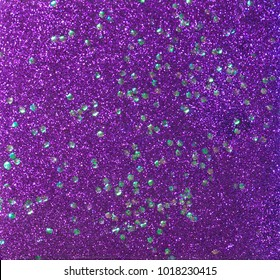 Purple glitter with chunky holographic glitter sprinkled in, sparkling background.