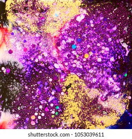 Purple and gold abstract composition with alcohol inks, and fine and chunky glitter in epoxy.
