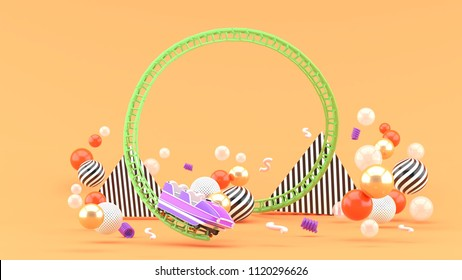 A purple roller coaster among colorful balls on an orange background.-3d rendering.