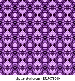 Purple seamless embroidery pattern. Ikat ethnic ornament. Seamless striped pattern. Geometric in Aztec style. Figure tribal embroidery.Tribal ethnic texture. Arabian,Scandinavian,Mexican,folk pattern.
