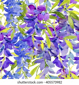 Purple wisteria flowers in spring. Watercolor seamless background.