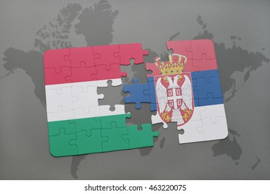 puzzle with the national flag of hungary and serbia on a world map background. 3D illustration