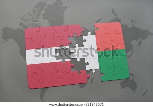 puzzle with the national flag of latvia and madagascar on a world map background. 3D illustration