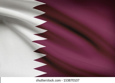 Qatari flag blowing in the wind. Part of a series.