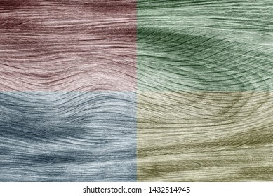 Quadrant colors of full frame rustic plank wooden texture, design by nature and different colors design on red, green, blue and sepia. Abstract background.