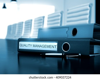 Quality Management - Folder on Wooden Desktop. File Folder with Inscription Quality Management on Black Working Desktop. Toned Image. 3D Rendering.