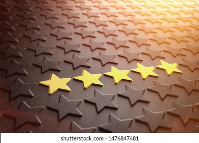 Quality rating, performance review, ranking, evaluation and classification concept, many stars on black background with focus on five gold stars