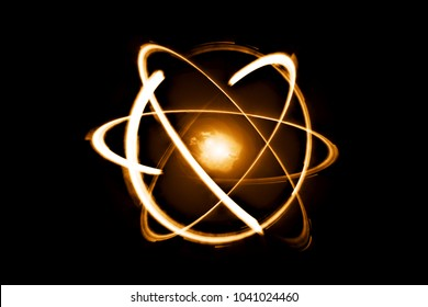 Quantum computer technology concept. Science yellow shining cosmic atom nuclear on black background.