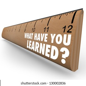 The question What Have You Learned? on a wooden ruler asking you to assess what knowledge you have attained through education, training or other life experience