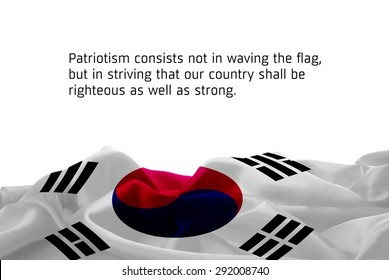 "Quote ""Patriotism consists not in waving the flag, but in striving that our country shall be righteous as well as strong"" waving abstract fabric South Korea flag on white background"