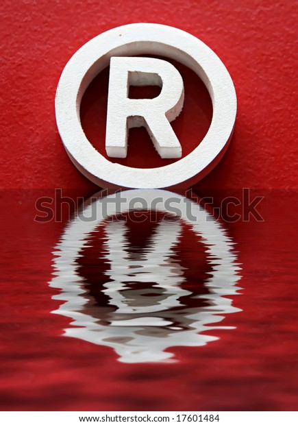 R trademark and reflection in red background