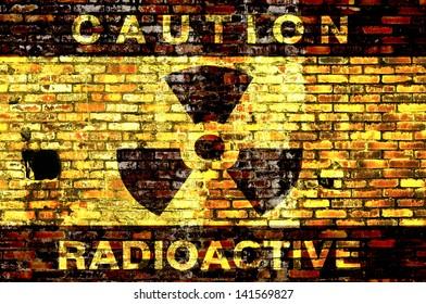 Radioactive symbol painted on old brick wall