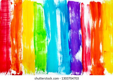Rainbow colored bright streaks of paint on a white background.