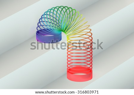 Rainbow colored plastic Slinky toy