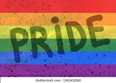 Rainbow flag on background with raindrops and inscription pride. LGBT community concept.
