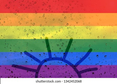 Rainbow flag on background with raindrops. Drawing the sun inside out. LGBT community concept.