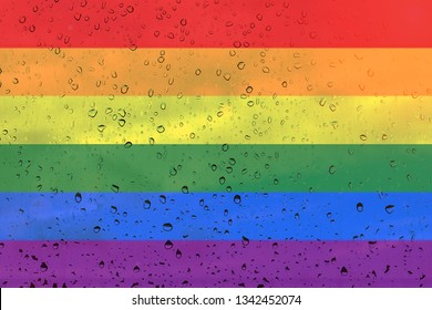 Rainbow flag on background with raindrops. Background texture. LGBT community concept.