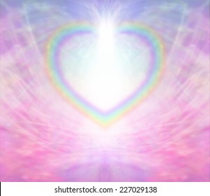Rainbow Heart Frame - Rainbow Heart shape making a border on a radiating delicate pink background with a light burst at the top of the heart