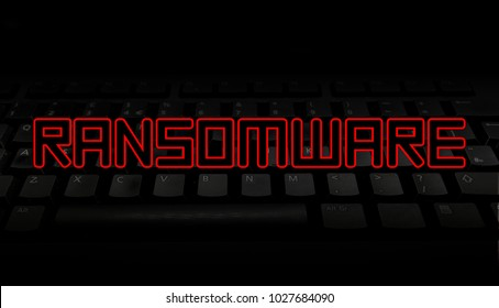 Ransomware red text over black keyboard illustration