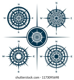 Raster set of blue isolated compass roses. Collection of different wind roses for graphic design. Raster illustration.