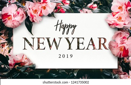 Real Flowers bloom background with Precious paper cut shape of typography & font text Happy New Year. Collection of brilliant flora background for all of your charming ideas on Season's Greetings.