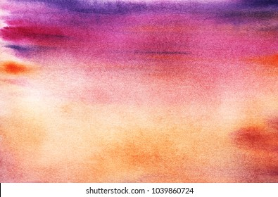 A real watercolor background of the sunset or the rising sky. purple pink orange. The sea horizon. Painted by hands.