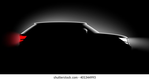 realistic off-road car iin the dark in the spotlight is a side view