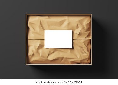 Realistic open gift box with wrapping paper and white business card on black background. Mock up. Top view. 3d rendering