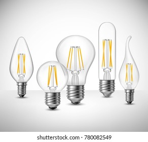 Realistic set of filament led lightbulbs on grey surface  illustration