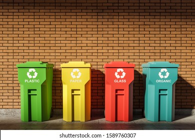 Recycling and environmental protection concept. Row of green, blue, red and yellow recycle bins standing near brick wall. 3d rendering