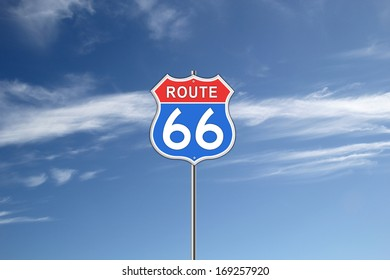 Red and blue Route 66 Road Sign isolated on blue sky background.