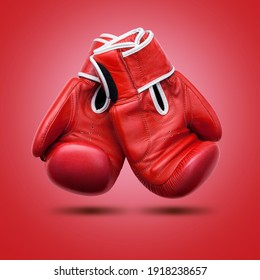 Red boxing gloves on a red background. 3d image