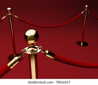 Red carpet with velvet rope barrier and shiny brass stanchions