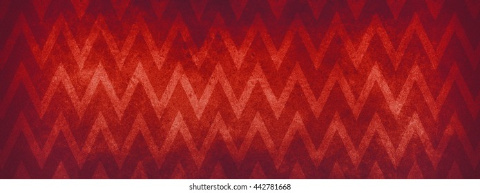 Red Christmas color background with a large chevron stripe design in a groovy zig zag pattern that has distressed vintage texture and a faint border vignette.