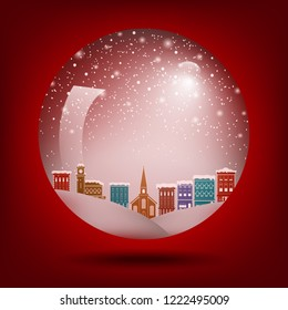 Red Christmas snow globe with a town inside