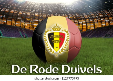 The Red Devils on Belgium language on football team ball on big stadium background. Belgium Team competition concept. Belgium flag on ball team tournament. Sport competition on green grass background