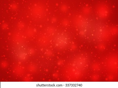 Red glitter sparkles defocused rays lights bokeh abstract christmas background.