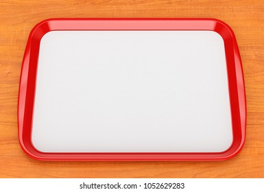 Red glossy plastic fast food tray with blank white advertising paper liner on wooden table surface. 3D illustration