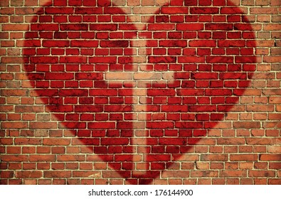 Red heart with cross on brick wall
