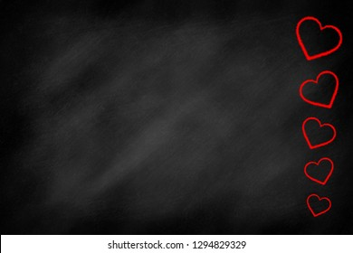 Red hearts on a blackboard, happy valentins day background