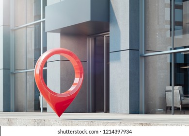 Red map geotag pin at street next to glass facade of modern building, 3d rendering.