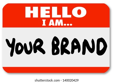 A red nametag sticker with words Hello I Am Your Brand to network yourself and promote your skills and abilities to win new business or land a new job in your career