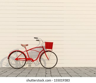 red retro bicycle with basket in front of the white wall, background