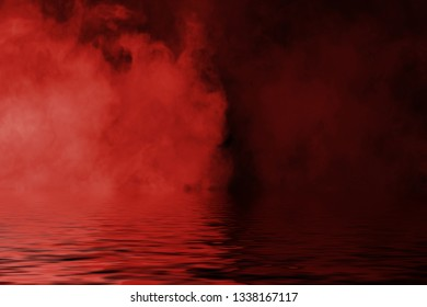 Red smoke with reflection in water. Mistery fog texture overlays background