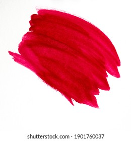 Red watercolor brush stroke on white background