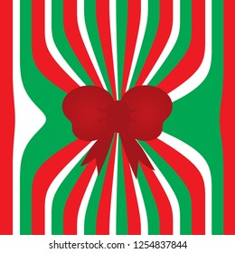 Red, White, and Green christmas wrapping paper background with bow.