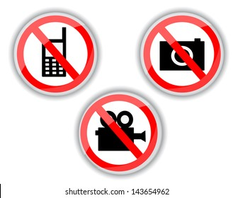 red and white prohibiting signs with telephone, video and photo camera