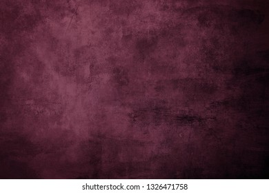 Reddish grungy distressed canvas bacground