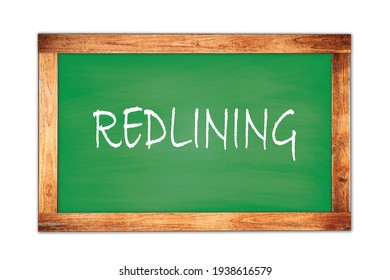 REDLINING text written on green wooden frame school blackboard.