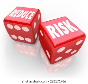 Reduce Risk words on two red dice to illustrate lowering your chances for liability, danger, hazard or exposure while increasing safety and security